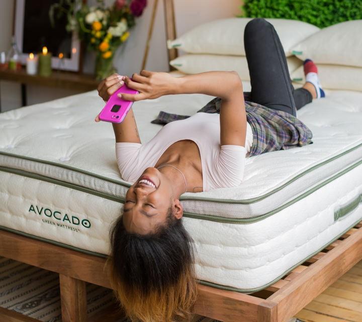 Avocado Green Natural Latex Mattressgirl with phone on bed