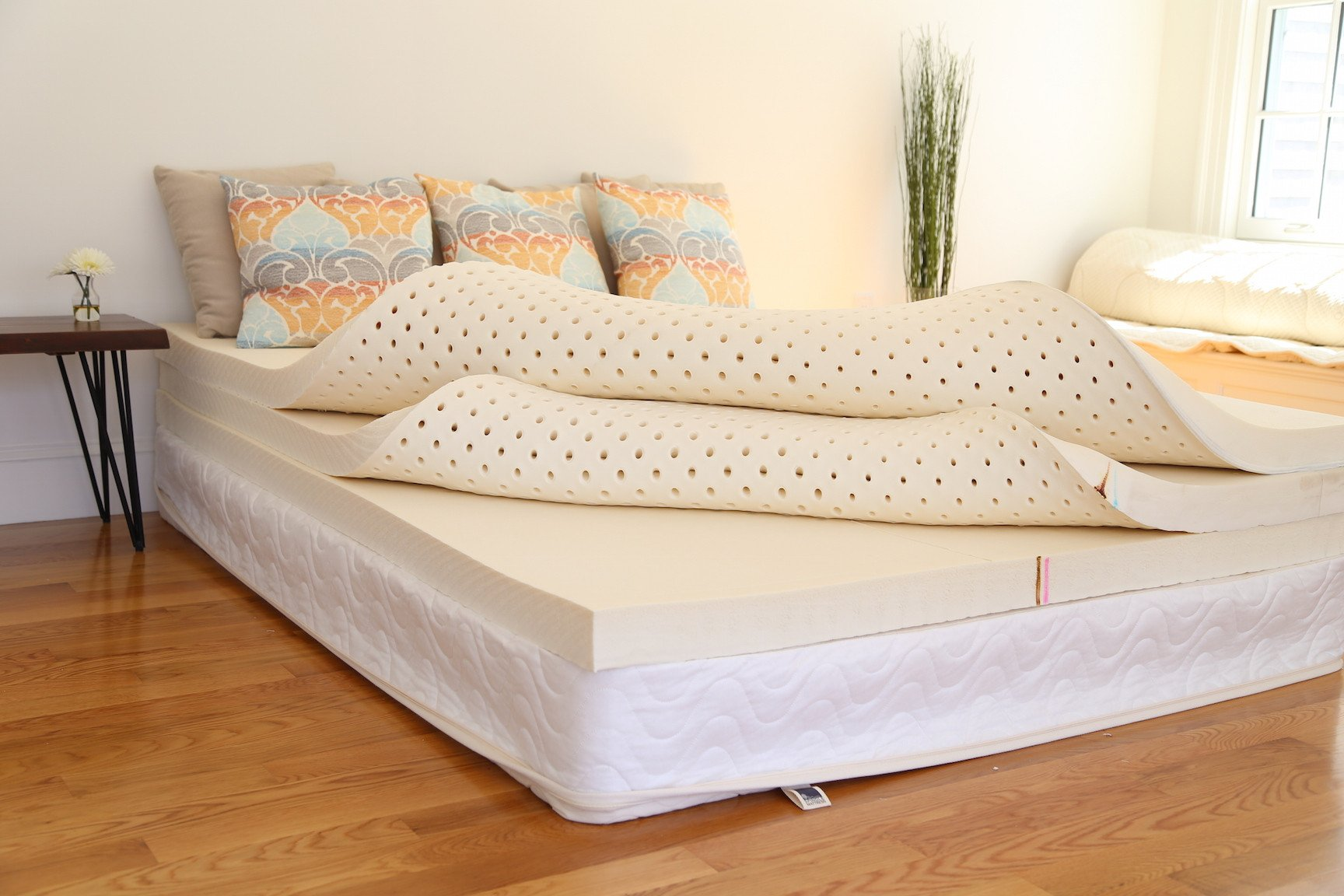 The Spindle natural latex mattress without the cotton/wool zippered cover pictured here. Three 3-inch Dunlop latex foam layers make up the core of the mattress.